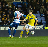 Leeds United's Luke Ayling (right) under pressure from Reading's Modou Barrow (left) <br /> <br /> Photographer David Horton/CameraSport<br /> <br /> The EFL Sky Bet Championship - Reading v Leeds United - Tuesday 12th March 2019 - Madejski Stadium - Reading<br /> <br /> World Copyright © 2019 CameraSport. All rights reserved. 43 Linden Ave. Countesthorpe. Leicester. England. LE8 5PG - Tel: +44 (0) 116 277 4147 - admin@camerasport.com - www.camerasport.com