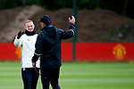 Wayne Rooney of Manchester United greets goalkeeping coach Silvino Louro during the Manchester United training session at the Carrington Training Centre, Manchester. Picture date: May 19th 2017. <br /> Pic credit should read: Matt McNulty/Sportimage