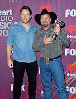 LOS ANGELES, CA. March 14, 2019: Chris Pratt &amp; Garth Brooks at the 2019 iHeartRadio Music Awards at the Microsoft Theatre.<br /> Picture: Paul Smith/Featureflash