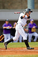 Lee Miller (16) of the Davidson Wildcats follows through on his swing against the Western Carolina Catamounts at Wilson Field on March 10, 2013 in Davidson, North Carolina.  The Catamounts defeated the Wildcats 5-2.  (Brian Westerholt/Four Seam Images)