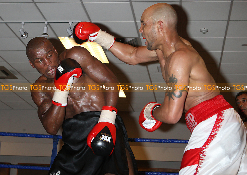 JJ (Jnr) Ojuederie (Watford, red/white shorts) defeats Andrew Lowe (Hackney, black shorts) in a Light-Heavyweight contest for the British Southern Area Title at the Royal National Hotel, Bloomsbury, promoted by WSO Sports - 16/05/08 - MANDATORY CREDIT: Gavin Ellis/TGSPHOTO. Self-Billing applies where appropriate. NO UNPAID USE. Tel: 0845 094 6026