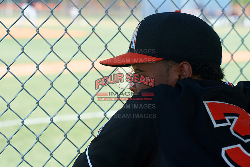 GCL Marlins Erwin Almonte (32) watches from the dugout during the first game of a doubleheader against the GCL Mets on July 24, 2015 at the St. Lucie Sports Complex in St. Lucie, Florida.  GCL Marlins defeated the GCL Mets 5-4.  (Mike Janes/Four Seam Images)