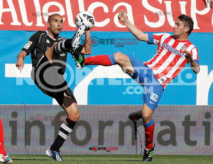 Atletico de Madrid's Koke (r) and Granada's Carlos Reina Aranda during La Liga match.April 14,2013. (ALTERPHOTOS/Acero)