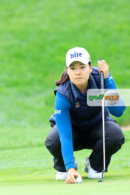In Gee Chun (KOR) lines up her putt on the 18th green during Saturday's Round 3 of The 2016 Evian Championship held at Evian Resort Golf Club, Evian-les-Bains, France. 17th September 2016.<br /> Picture: Eoin Clarke   Golffile<br /> <br /> <br /> All photos usage must carry mandatory copyright credit (&copy; Golffile   Eoin Clarke)