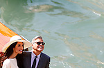 George Clooney and Amal Alamuddin leaves Ca'Farsetti in direction of Ponte Rialto Bridge, on September 29, 2014, where George Clooney and his wife Amal Alamuddin where they have registered their wedding. PHOTO / PIERRE TEYSSOT