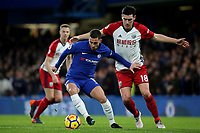 Chelsea's Eden Hazard shields the ball from West Brom's Gareth Barry during Chelsea vs West Bromwich Albion, Premier League Football at Stamford Bridge on 12th February 2018