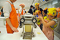 "September 17, 2011 : Yokohama, Japan - Kids are making their handmade Chikin Ramen during the grand opening of the Nissin Cup Noodles Museum. Visitors can learn about the history of the Cup Noodles product and partake in a session to make their own homemade instant ramen noodles at the museum's ""Chikin Noodle Factory"". The museum's art director, Kashiwa Sato, is also in charge of graphic design for the massive Japanese clothes retailer Uniqlo. (Photo by Yumeto Yamazaki/AFLO)"