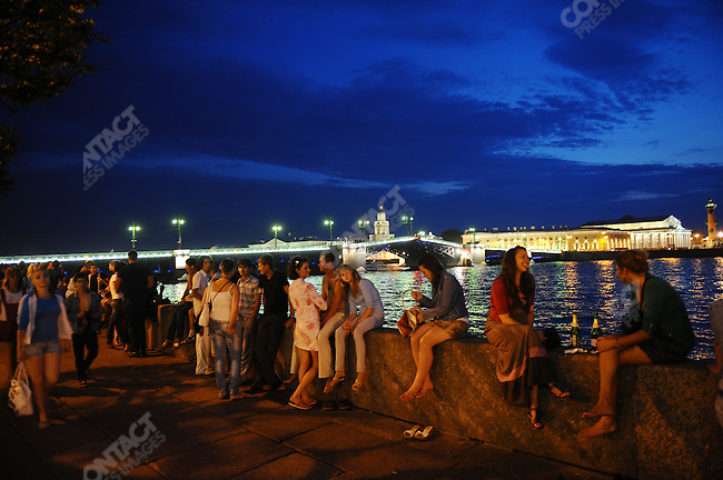 People waited on the banks of the river Neva, during White Nights, for the raising of the bridges at 1.30 a.m., St. Petersburg, Russia, July 9, 2010..