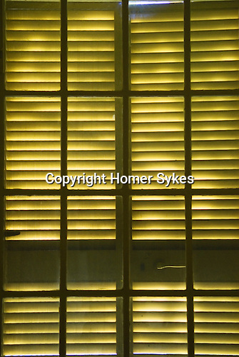 Pettern from light through wooden window shutters.