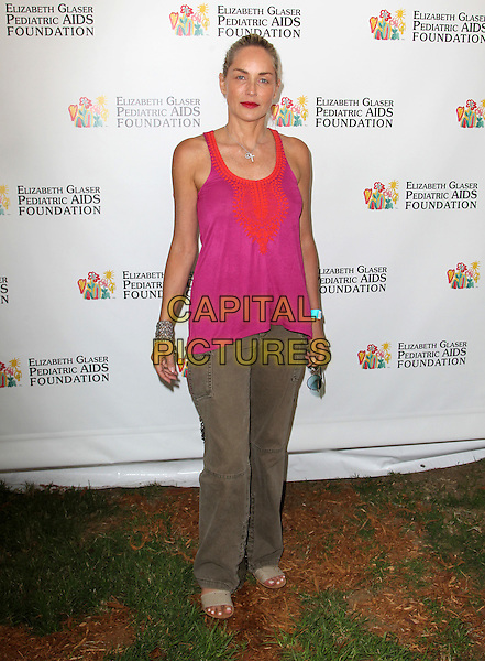 Sharon Stone.Elizabeth Glaser Pediatric AIDS Foundation's 23rd Annual 'A Time For Heroes' Celebrity Picnic held at The Wadsworth Theater, Los Angeles, California, USA..3rd June 2012.full length top sleeveless pink red top brown trousers     .CAP/ADM/FS.©Faye Sadou/AdMedia/Capital Pictures.