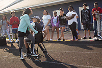 Freshman Scarlett Vargas, 14, and Patrick Long, 14 (BOTH CQ) play musical chairs during a Peer Group Connection field day where freshmen students meet their senior mentors at Greene Central Central High School in Snow Hill, NC Friday, September 22, 2017. (Justin Cook for Education Week)