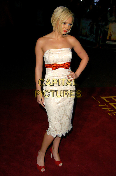 "CHANELLE HAYES.UK Premiere of ""Elizabeth - The Golden Age"" at the Odeon Leicester Square, London, England..October 23rd 2007.full length white dress lace strapless hand on hip bow red shoes .CAP/CAN.©Can Nguyen/Capital Pictures"