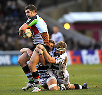 Heineken Cup. Twickenham, England. Nick Easter of Harlequins tackled during the Heineken Cup Pool 3 match between Harlequins and Zebre at Twickenham Stoop onDecember 15, 2012 in Twickenham, England.