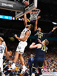 SAN ANTONIO, TX - APRIL 02:  Omari Spellman #14 of the Villanova Wildcats shoots the ball against Muhammad-Ali Abdur-Rahkman #12 of the Michigan Wolverines in the 2018 NCAA Men's Final Four National Championship game at the Alamodome on April 2, 2018 in San Antonio, Texas.  (Photo by Jamie Schwaberow/NCAA Photos via Getty Images)