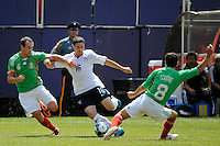 Jay Heaps (16) of the United States (USA) is defended by Gerardo Torrado (6) and Israel Castro (8) of Mexico (MEX). Mexico (MEX) defeated the United States (USA) 5-0 during the finals of the CONCACAF Gold Cup at Giants Stadium in East Rutherford, NJ, on July 26, 2009.