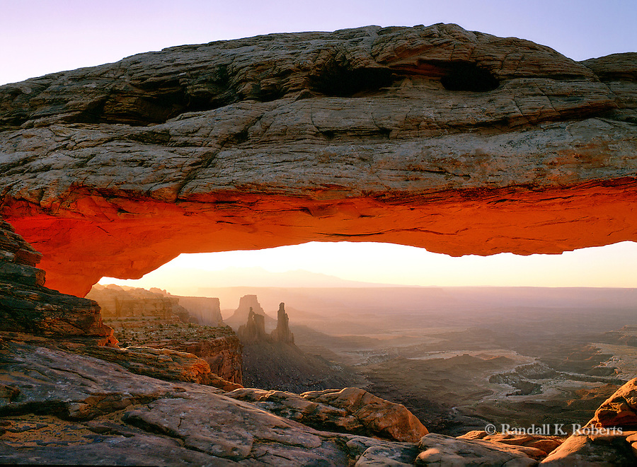 Sunrise lights up in the inside of Mesa Arch in the Canyonlands National Park near Moab, Utah.