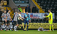 The Referee walks over to hand floored Michael O'Connor of Notts Co a red card while teammates protest during the Sky Bet League 2 match between Notts County and Wycombe Wanderers at Meadow Lane, Nottingham, England on 10 December 2016. Photo by Andy Rowland.