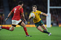 Bernard Foley of Australia looks to go round Scott Baldwin of Wales during Match 35 of the Rugby World Cup 2015 between Australia and Wales - 10/10/2015 - Twickenham Stadium, London<br /> Mandatory Credit: Rob Munro/Stewart Communications