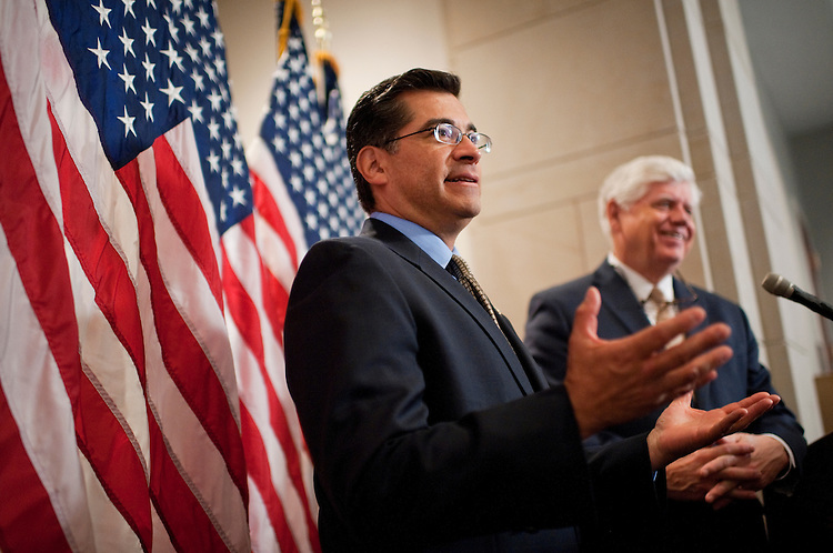 UNITED STATES - FEBRUARY 15:  Democratic Conference Chairman John Larson, D-Conn., right, and Vice Chairman Xavier Becerra, D-Calif., conduct a news conference after a meeting of the House Democratic Caucus in the Capitol Visitor Center.  (Photo By Tom Williams/CQ Roll Call)