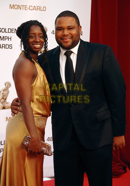ANTHONY ANDERSON.At the Golden Nymph awards ceremony during the 2008 Monte Carlo Television Festival held at Grimaldi Forum, Monte Carlo, Principality of Monaco, .June 12, 2008..half length gold dress black suit tie long.CAP/TTL .©TTL/Capital Pictures