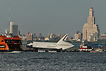 The space shuttle Enterprise is towed by barge past  Brooklyn June 3, 2012 in New York on its way to dock in Port Elizabeth, New Jersey. Enterprise is scheduled to be moved by barge June 5 to the Intrepid Sea.  Photo by Kena Betancur / VIEWpress..