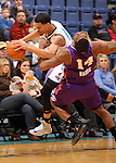 SIOUX FALLS, SD - FEBRUARY 19:  Mustapha Farrakhan #9 from the Sioux Falls Skyforce draws a blocking foul on Paul Harris #14 from the Iowa Energy in the first half of their game Tuesday night at the Sioux Falls Arena. (Photo by Dave Eggen/Inertia)