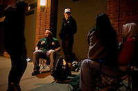 Fans wait outside Fenway Park to guarantee game-day tickets on the night before the opening day of the Boston Red Sox 2011 season in Boston, Massachusetts.