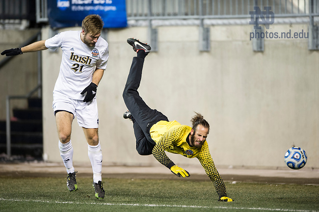 Dec. 13, 2013; Notre Dame forward Vince Cicciarelli pressures New Mexico goalkeeper Michael Lisch in the second half of the College Cup semifinals at PPL Park in Chester, Pa. Notre Dame advances to the finals after defeating New Mexico 2-0. Photo by Barbara Johnston/University of Notre Dame