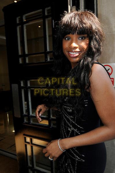 JENNIFER HUDSON .At BBC Radio 2, London, England, UK, April 20th 2011..half length black sleeveless dress fringe smiling .CAP/IA.©Ian Allis/Capital Pictures.