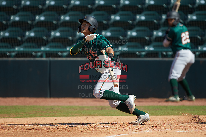 Ji-Hwan Bae (51) of the Greensboro Grasshoppers attempts a bunt against the Hickory Crawdads at L.P. Frans Stadium on May 26, 2019 in Hickory, North Carolina. The Crawdads defeated the Grasshoppers 10-8. (Brian Westerholt/Four Seam Images)