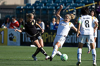 Lisa Sari (12) tries to stop the pass of Leslie Osborne (10). Los Angeles Sol defeated FC Gold Pride 2-0 at Buck Shaw Stadium in Santa Clara, California on May 24, 2009.