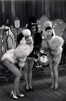 BNPS.co.uk (01202 558833)<br /> Pic: Dukes/BNPS<br /> <br /> 'If it moves, its rude' risque routines that escaped censure in the 1950's revealed in photo album from the legendary Windmill Theatre.<br /> <br /> Racy photos of scantily clad women performing at an iconic theatre have been unearthed which reveal that post-war London was not quite as conservative as some would imagine.<br /> <br /> Dancers at the Windmill Theatre in Soho would pose nude as 'living statues' to exploit a quirky legislation loophole permitting them to bare all if stood completely still. <br /> <br /> They were not allowed to move because this would have been a breach of licensing regulations which adopted the position 'if it moves, it's rude'. <br /> <br /> As a result, men from across the globe savoured the delights of the venue in central London, and there would often be fights over front row seats as they battled for the best views.<br /> <br /> The photos will be sold at Duke's Auctioneers of Dorchester on March 21.