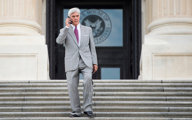 UNITED STATES - JULY 29: Rep. Roger Williams, R-Calif., talks on his cell phone on the House steps at the Capitol in between votes on Wednesday, July 29, 2015. (Photo By Bill Clark/CQ Roll Call)