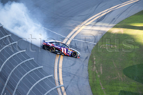 21.02.2016. Daytona Beach. Florida, USA.   Denny Hamlin (11) celebrates his win of the Daytona 500 at the Daytona International Speedway in Daytona Beach, FL by performing doughnut turns