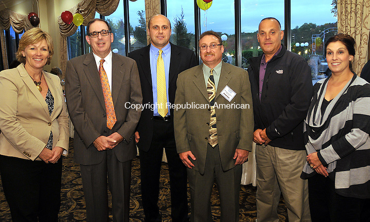 WATERBURY, CT 12 OCTOBER 2011--101211JS13---Mary Ann Hebert, Frank Travisano, Advocate of Youth Award recipient Lt. Robert Cizauskas of the Waterbury Police Department, Middlebury Police Chief Richard Guisti, Waterbury police officer rank Santopietro and his wife Lori Santopietro at  the annual Waterbury Youth Services Champions of Youth Fall Gala held at the Ponte Club in Waterbury. <br /> Jim Shannon Republican-American