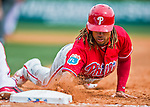 11 March 2016: Philadelphia Phillies infielder Emmanuel Burriss dives safely back to first on a pickoff attempt during a Spring Training pre-season game against the Atlanta Braves at Champion Stadium in the ESPN Wide World of Sports Complex in Kissimmee, Florida. The Phillies defeated the Braves 9-2 in Grapefruit League play. Mandatory Credit: Ed Wolfstein Photo *** RAW (NEF) Image File Available ***