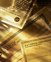 Financial documents and stock certificates.