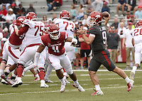 NWA Democrat-Gazette/ANDY SHUPE<br /> Arkansas quarterback John Stephen Jones (9) rolls out to pass Saturday, April 6, 2019, as defensive lineman Mataio Soli (11) defends during the Razorbacks' spring game in Razorback Stadium in Fayetteville. Visit nwadg.com/photos to see more photographs from the game.