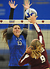 Amanda Goldstein #13 of Centereach, left, defends against spike attempt by Noelle Bryggman #9 of Whitman during a non-league varsity girls volleyball match at New York Institute of Technology in Old Westbury on Wednesday, Sept. 20, 2017.