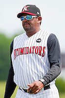 Kannapolis Intimidators pitching coach Jose Batista #38 walks off the field during the game against the Lexington Legends at Fieldcrest Cannon Stadium on May 11, 2011 in Kannapolis, North Carolina.   Photo by Brian Westerholt / Four Seam Images