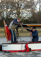 PUTNEY, LONDON, ENGLAND, 05.03.2006, Chas Newans guys' clear debris from the prop shaft of 'Pommery'.Pre 2006 Boat Race Fixtures,.   © Peter Spurrier/Intersport-images.com..CUBC, Bow Luke Walton, No. 2 Tom Edwards, No.3 Sebastian Thormann, No 4. Thorsten Englemann, No.5 Sebastian Schulte, No.6 Kieran West, No.7 Tom James, stroke Kip McDaniel and cox Peter Rudge...OUBC, Bow Robin Esjmond-Frey, No.2 Colin Smith, No.3 Jake Wetzel, No.4 Paul Daniels, No.5 James Schroeder. No.6 Barney Williams, No. 7 Tom Parker, stroke Bastien Ripoll, and cox Nick Brodie,..[Mandatory Credit Peter Spurrier/ Intersport Images] Varsity Boat Race, Rowing Course: River Thames, Championship course, Putney to Mortlake 4.25 Miles