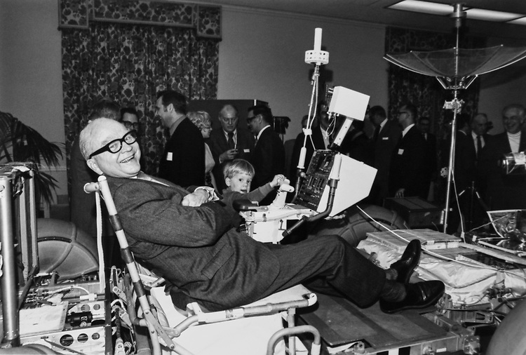 Congressman having fun while sitting on Boeing racer machine. (Photo by Dev O'Neill/CQ Roll Call via Getty Images)