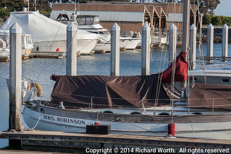 """Moored at the San Leandro Marina, a sail boat named """"Mrs. Robinson""""."""