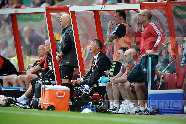 Sheffield United Manager Nigel Adkins watches from the dugout<br /> - English League One - Swindon Town vs Sheffield Utd - County Ground Stadium - Swindon - England - 29th August 2015