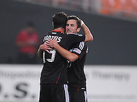 D.C. United midfielder Stephen King (20) celebrates with teammate Chris Pontius (13) his score in the 81th minute of the game. D.C.United defeated The Vancouver Whitecaps FC 4-0 at RFK Stadium, Saturday August 13 , 2011.