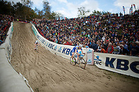U23 European Champion Michael Vanthourenhout (BEL/Sunweb-Napoleon Games) proceeds U23 World Champion Wout Van Aert (BEL/Vastgoedservice-Golden Palace) going into &quot;The Pit&quot;<br /> <br /> GP Zonhoven 2014