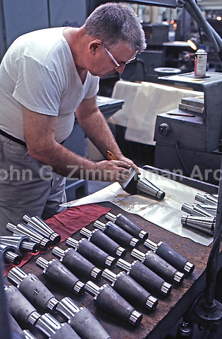 Worker at Gary Steel Works Finishing Facility, US Steel Corporation, Gary, Indiana, 1966. Finished parts were used in automotive, metal parts components, home construction and appliance markets. Photo by John G. Zimmerman.