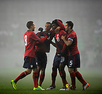 Edson Buddle (2.o.r, USA) and Timothy Chandler ( USA) and Carlos Bocanegra (r, USA) and Fabian Johnson (l, USA) celebrates after the Goal to 1:0, during the friendly match Slovenia against USA at the Stozice Stadium in Ljubljana, Slovenia on November 15th, 2011.