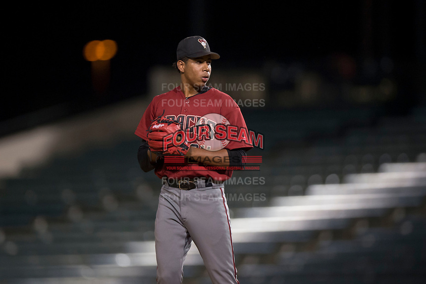 AZL Diamondbacks relief pitcher Raibel Custodio (24) prepares to deliver a pitch during an Arizona League game against the AZL Angels at Tempe Diablo Stadium on June 27, 2018 in Tempe, Arizona. The AZL Angels defeated the AZL Diamondbacks 5-3. (Zachary Lucy/Four Seam Images)