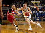 BROOKINGS, SD - FEBRUARY 23: Noah Freidel #11 of the South Dakota State Jackrabbits drives to the basket past Cody Kelley #10 of the South Dakota Coyotes Sunday at Frost Arena in Brookings, SD. (Photo by Dave Eggen/Inertia)